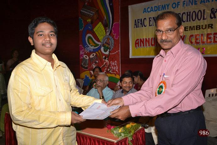 Police Inspector Mr. Sunil Kadam felicitating Master Prasad Dongre
