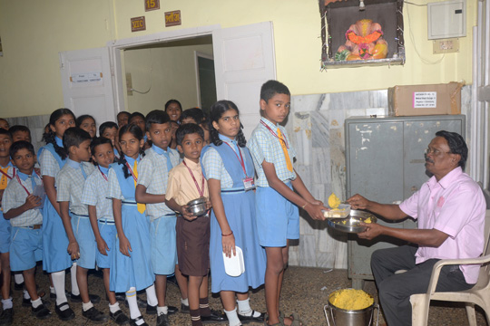 Mid day Meals to students from Std V to VIII