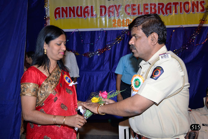 Police Inspector Mr. Balasaheb Jadhav felicitating Mrs. Sandra Noronha