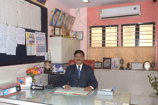 Principal Mr. S. N. Pawar in his office