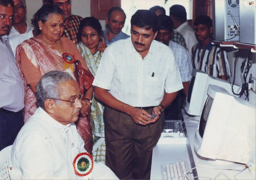 Jitendra sir explaining about computers to the then Higher Education Minister Shri Dattaji Rane